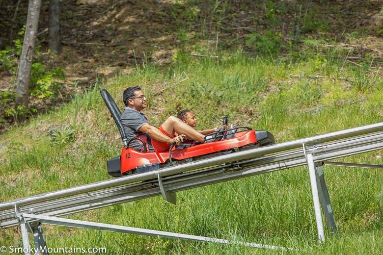 Father and child riding Gatlinburg Mountain Coaster