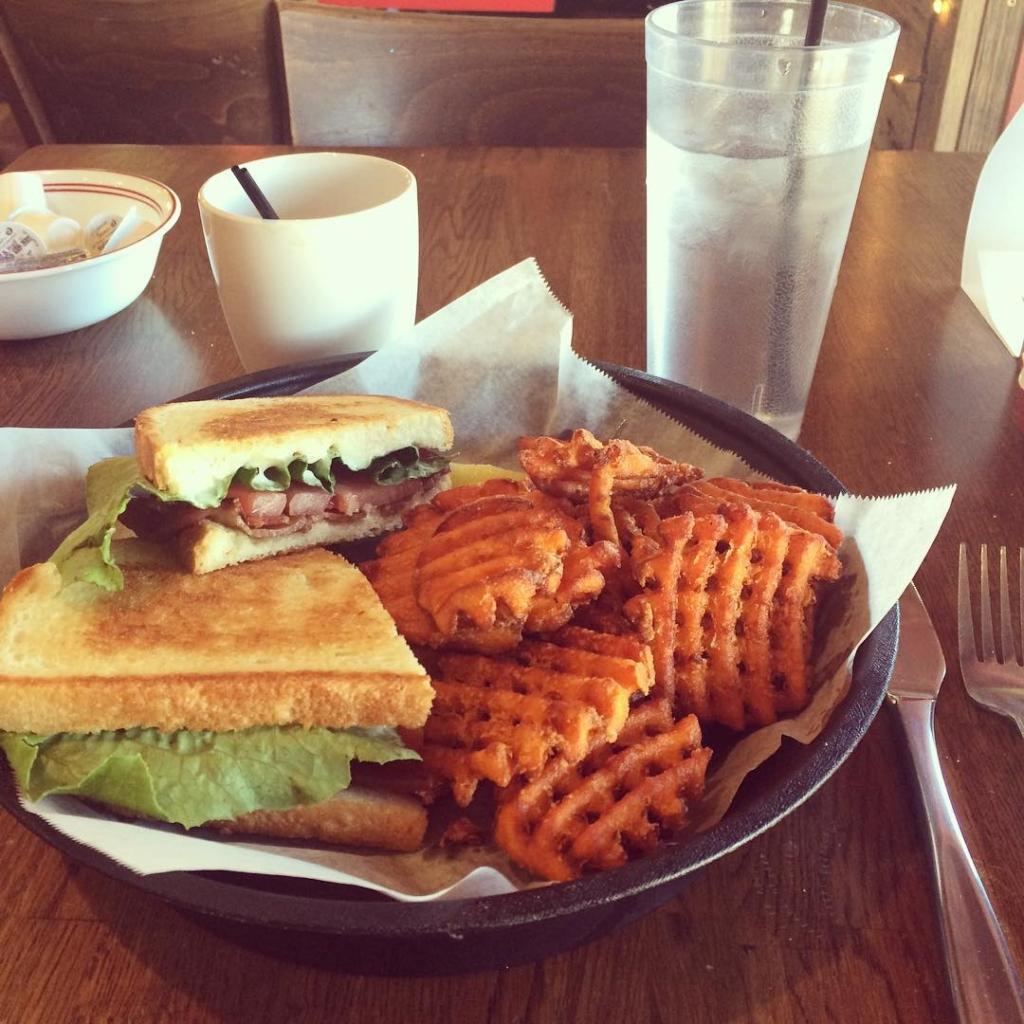 Sandwich and sweet potato waffle fries at Elvira's cafe