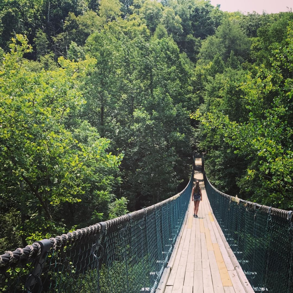 Girl Walking on Swinging Bridge