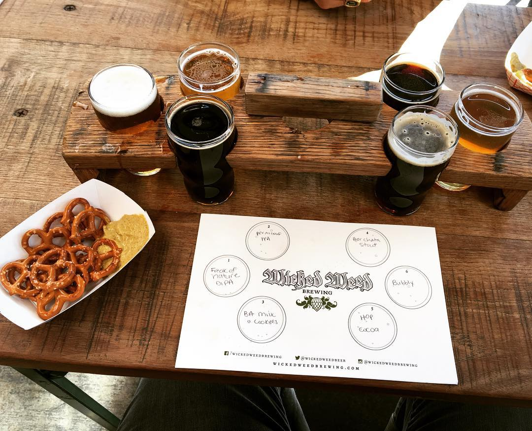 Beer flight and pretzels at Wicked Weed Brewing