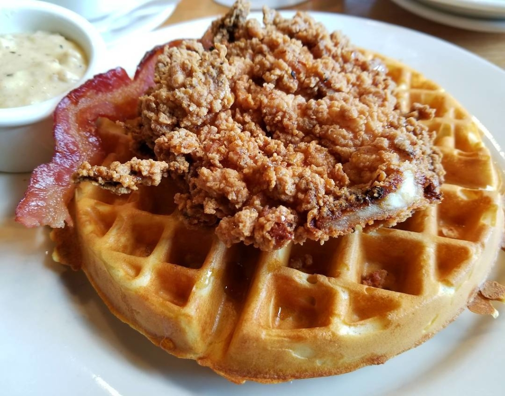 Fried chicken and bacon on a waffle.