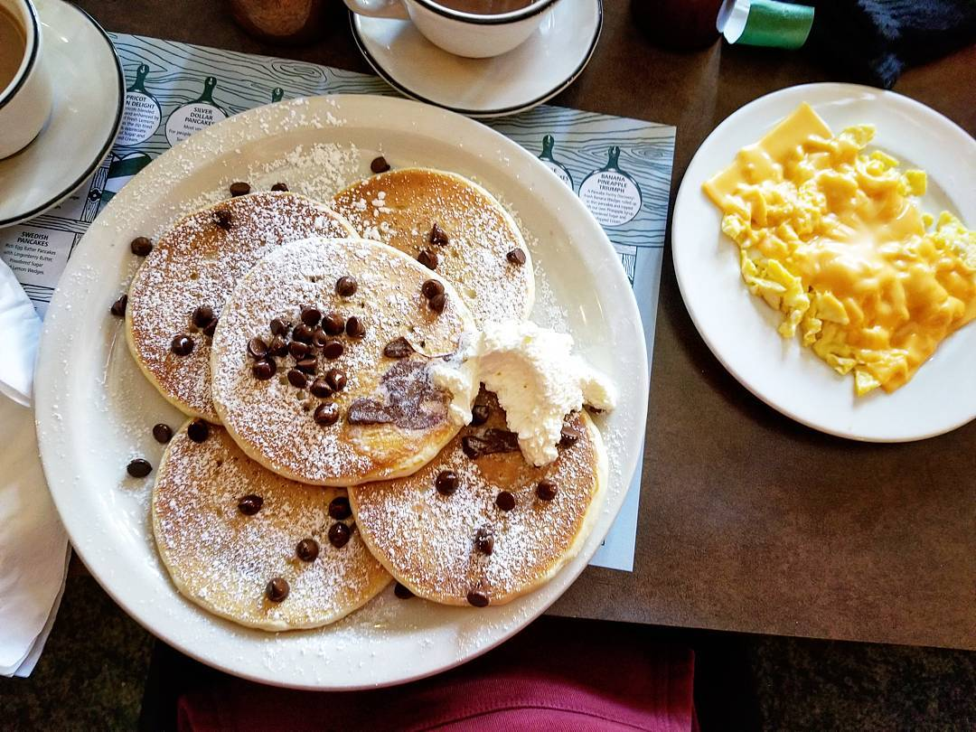 Chocolate Chip pancakes with a side of cheesy eggs
