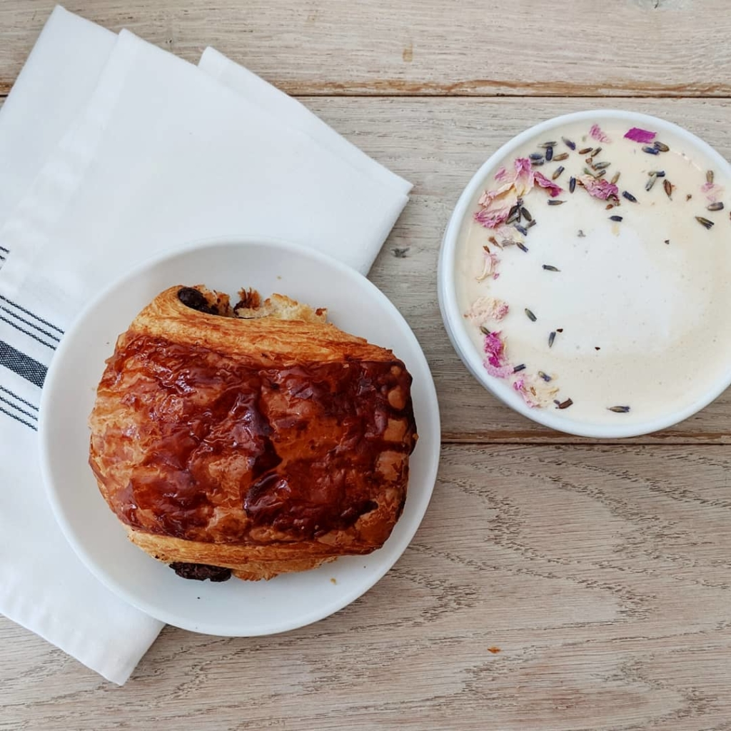 croissant on plate and latte on table