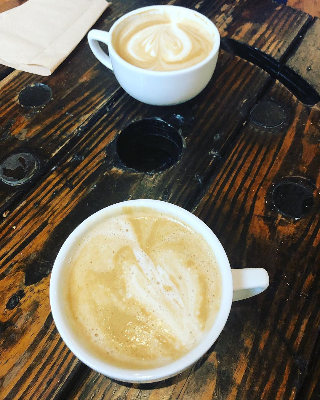 two lattes on a table