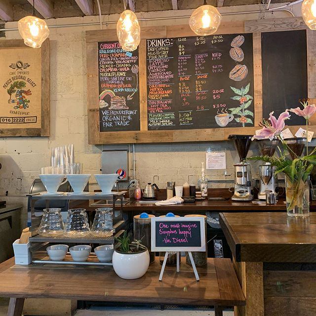 coffee shop counter with flowers and menu board