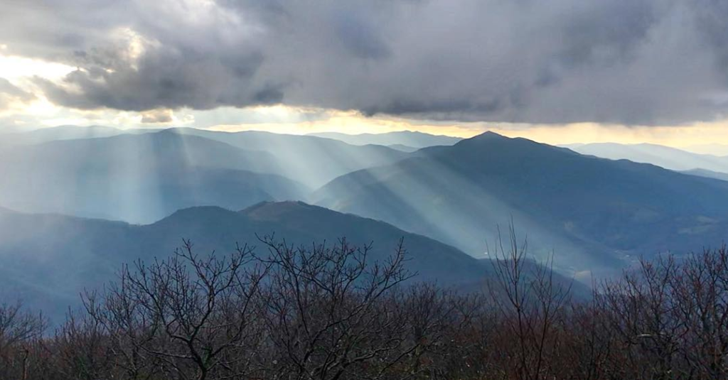 Sun shing through the clouds over mount pisgah