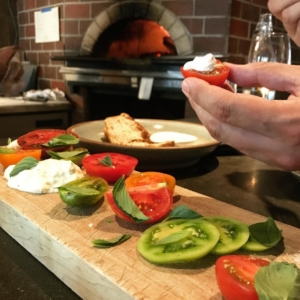 Tomatoes and creme fraiche on butcher block