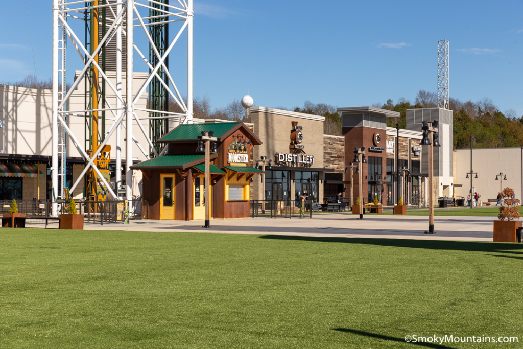 row of shops and green grass at the mountain mile in pigeon forge tn